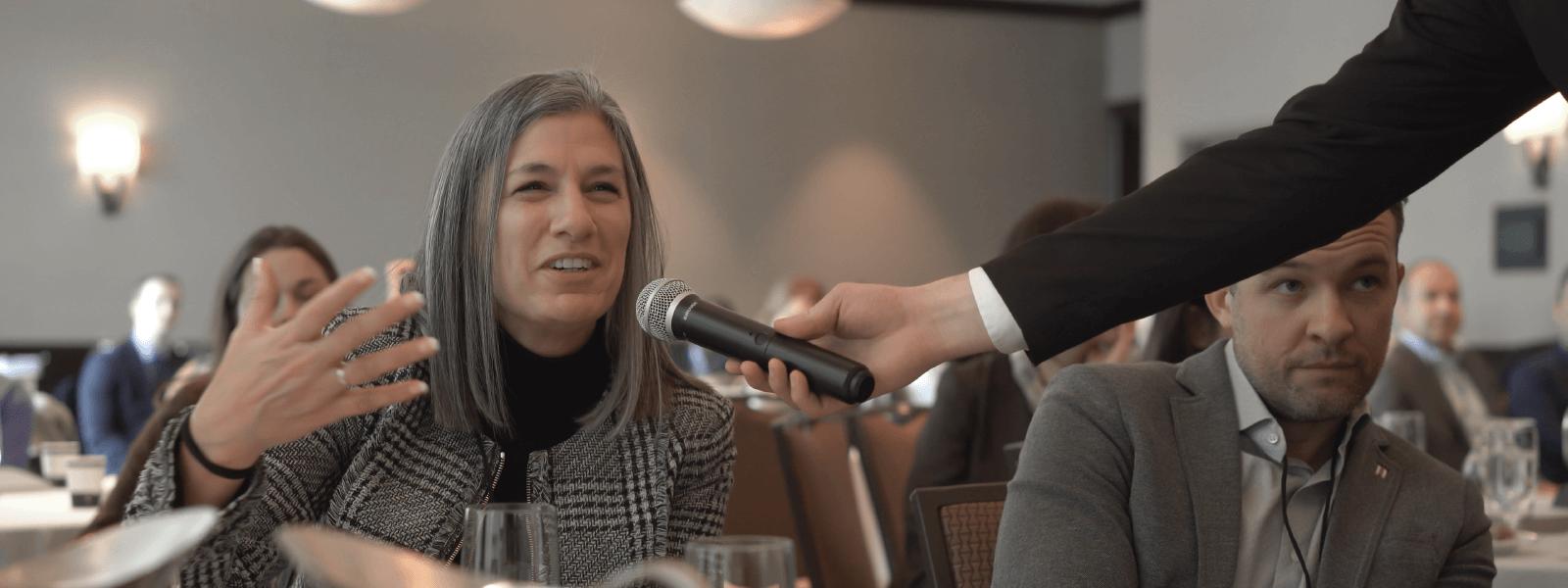 Woman asking question at Tenant Talks